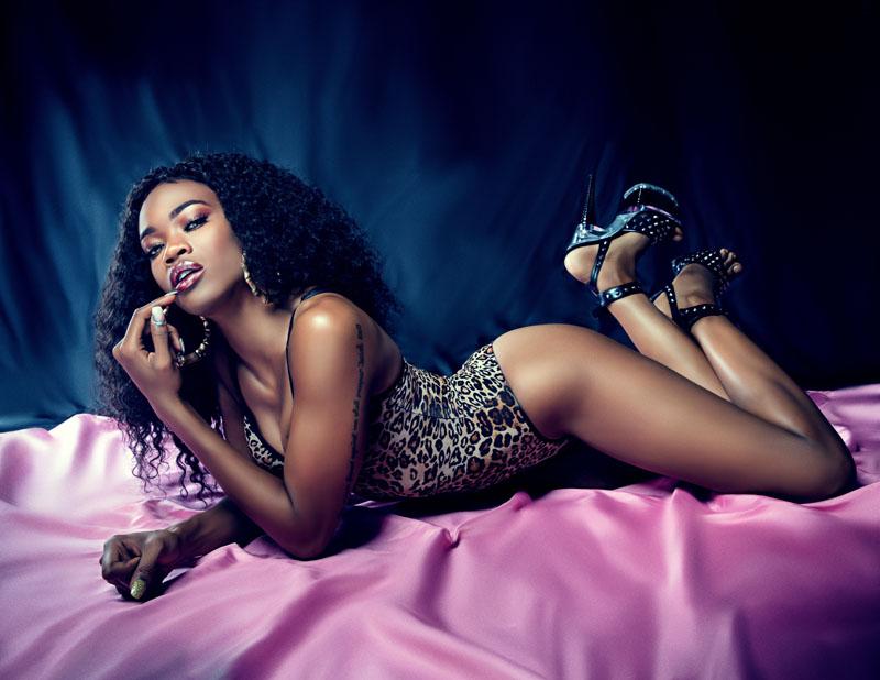 dark skinned woman in leopard print bodysuit.