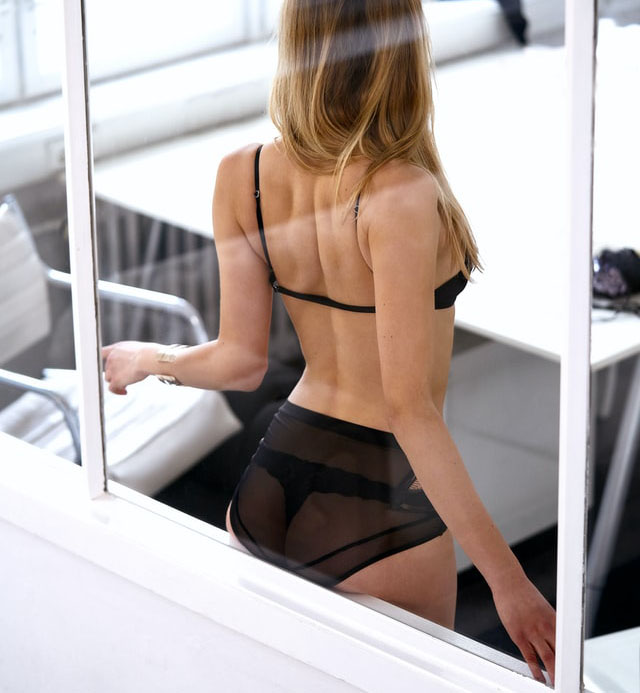 Sexy Secretary through office window